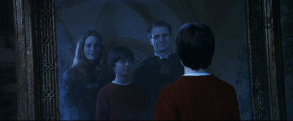 Harry Potter beguiled by the Mirror of Erised in the first movie.