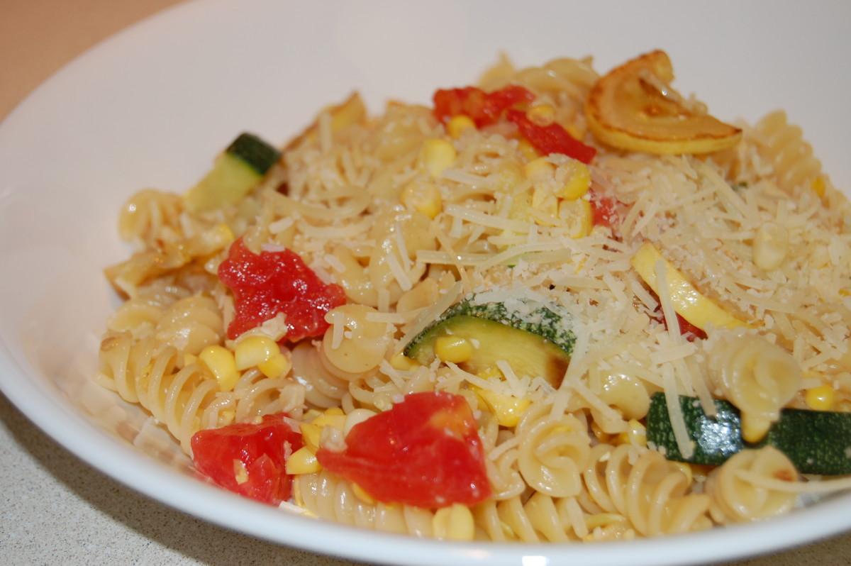 Corkscrew pasta with fresh tomato, yellow squash, zucchini, and corn