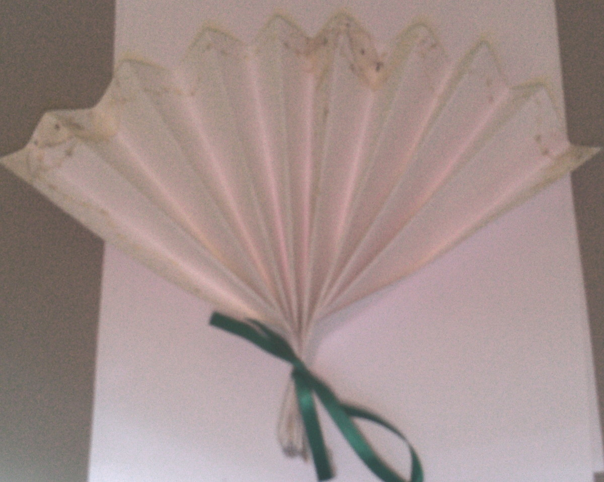 Use a ribbon to tie the paper fans together.  (Photo Taken By Sweetiepie On Hubpages