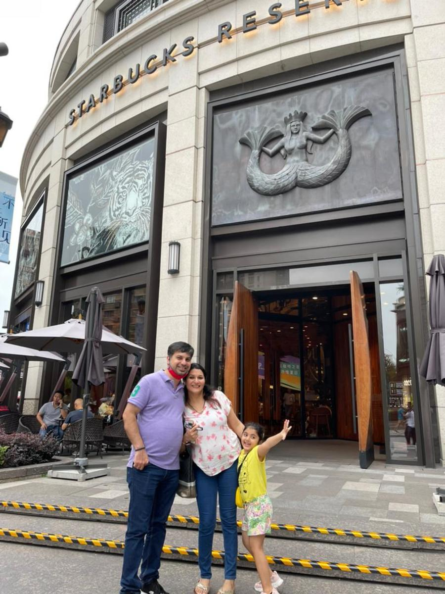My Daughter, Son-in-law and Granddaughter outside the Starbucks Roastery in China