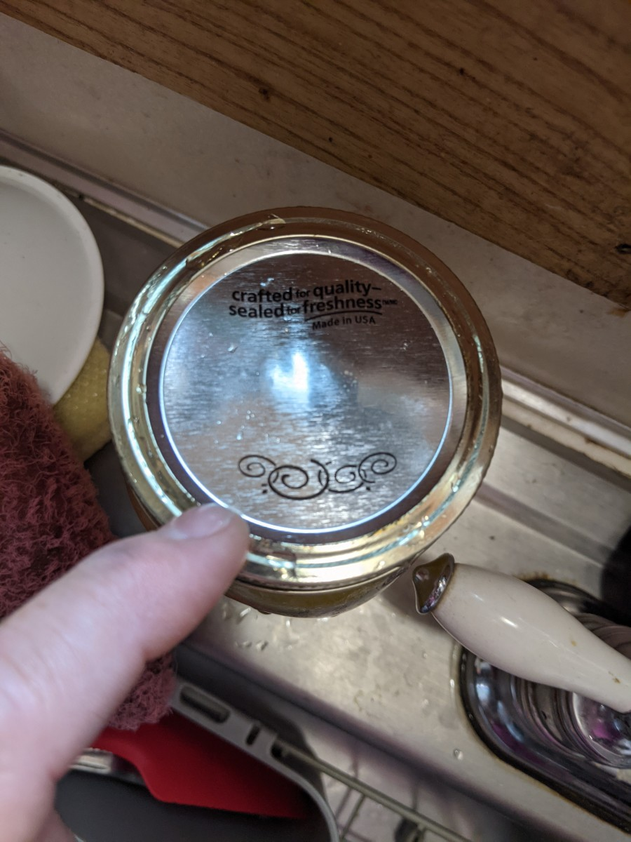 Button on top of jar will suck down and flatten or dimple down when sealed.