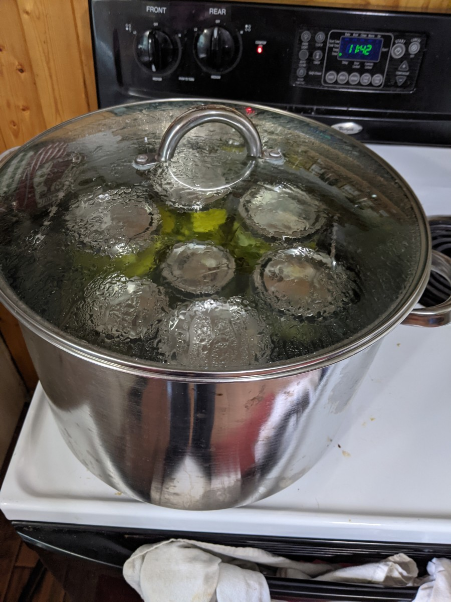 Place completed jars into boiling water bath canner. Make sure there is at least a little bit of water over the jars. Rule of thumb is inch above jars. Place lid on pan. Set timer to either 10 minutes for pints or 15 minutes for quarts.