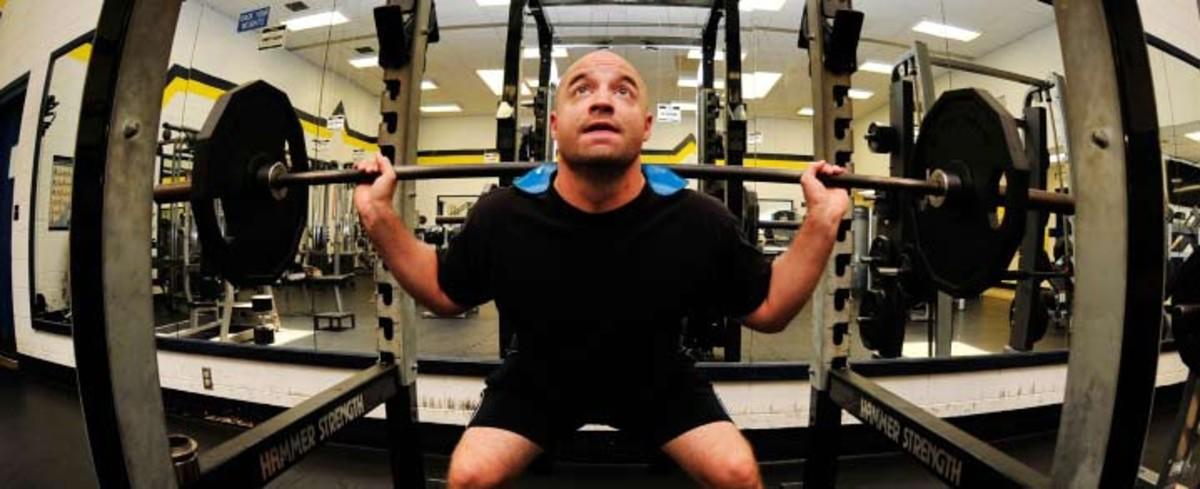 Image of man lifting weights.
