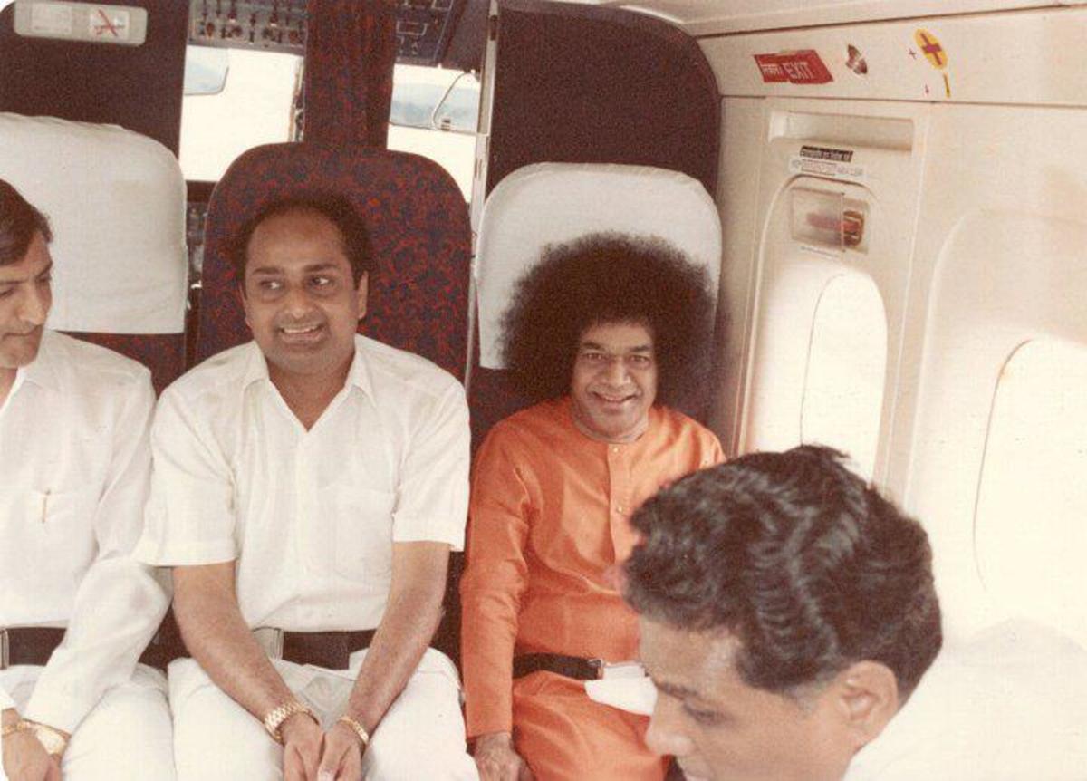 C Sreenivas beside Bhagawan
