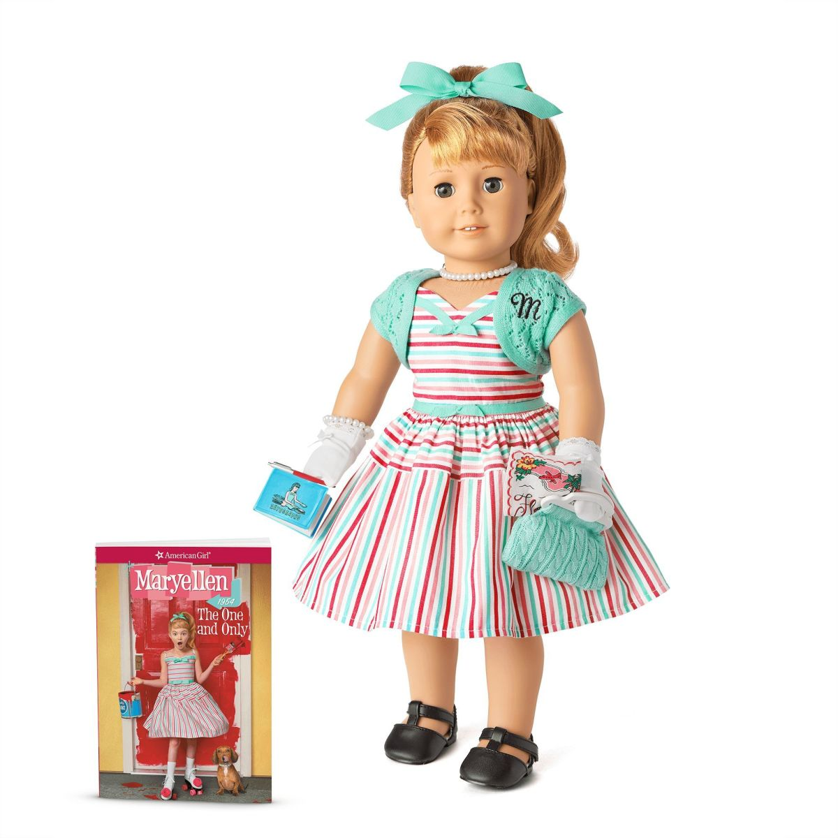 A Maryellen doll, pictured with the book Maryellen: The One and Only