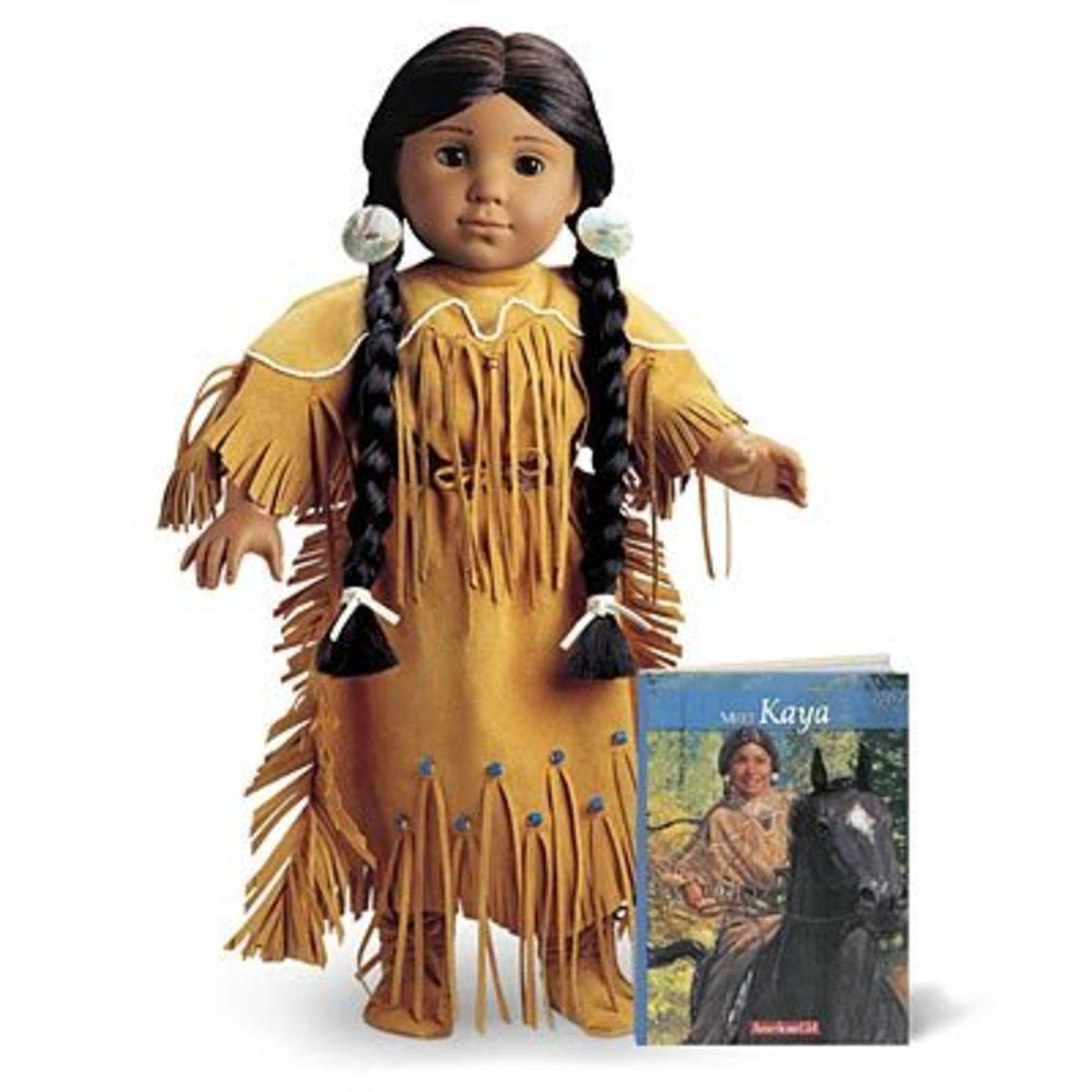 The original version of the Kaya doll, posed with the Meet Kaya book