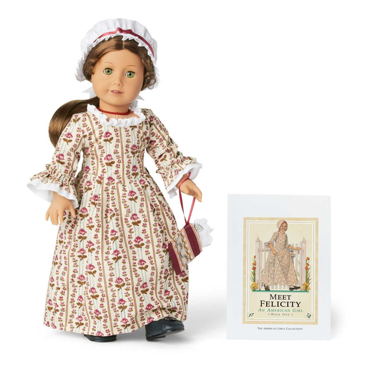 The 35th Anniversary Felicity doll in her original Meet Outfit, pictured wearing her original accessories and posed in front of a Meet Felicity book