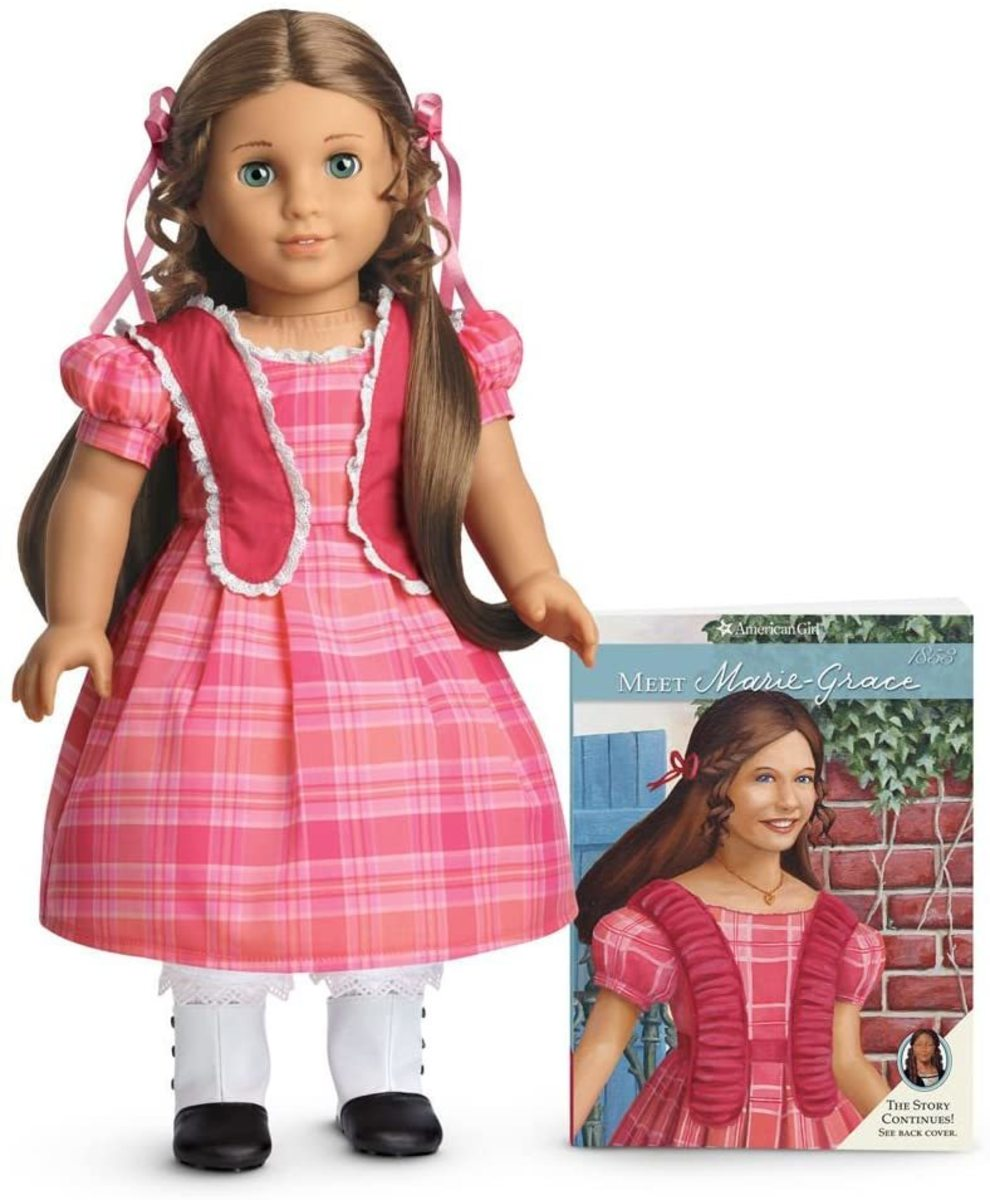 The Marie-Grace doll, pictured with the Meet Marie-Grace book