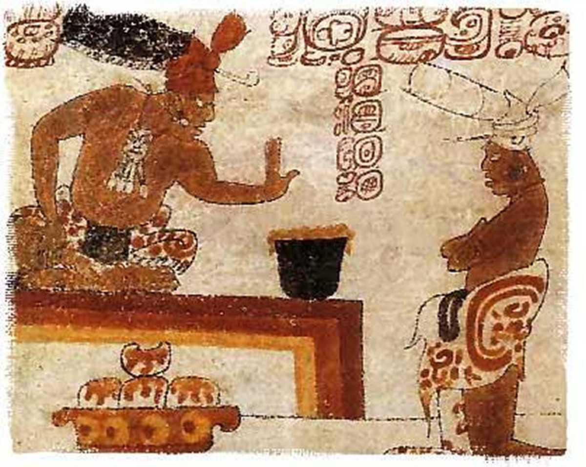 Two Mayans sit around a container of frothed chocolate.