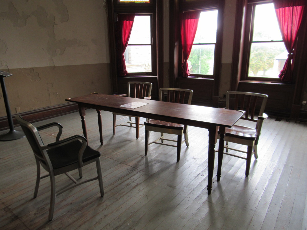Residential room for the chaplain. This also served as the parole board room in The Shawshank Redemption.