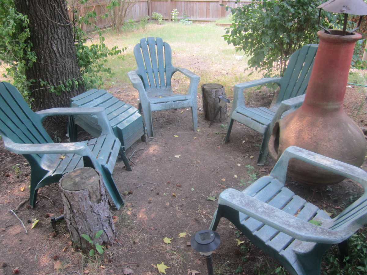 I got this whole set of chairs and footstools for $10--delivered! Yard sales are a great source for cheap patio furniture.