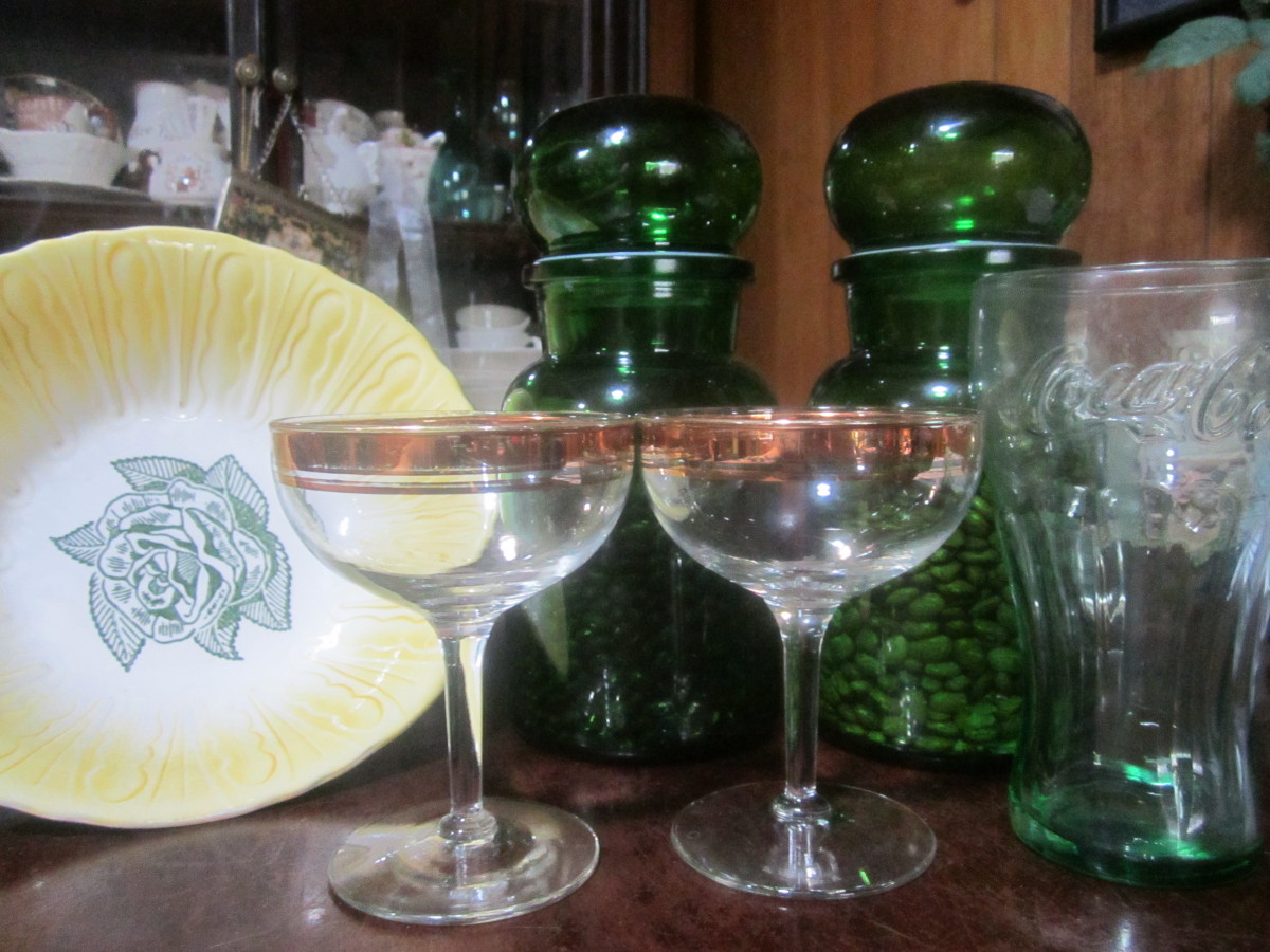 Green cannisters for beans, cool old bowl, champagne glasses, and Coke glass. Kitchen items are plentiful at yard sales.