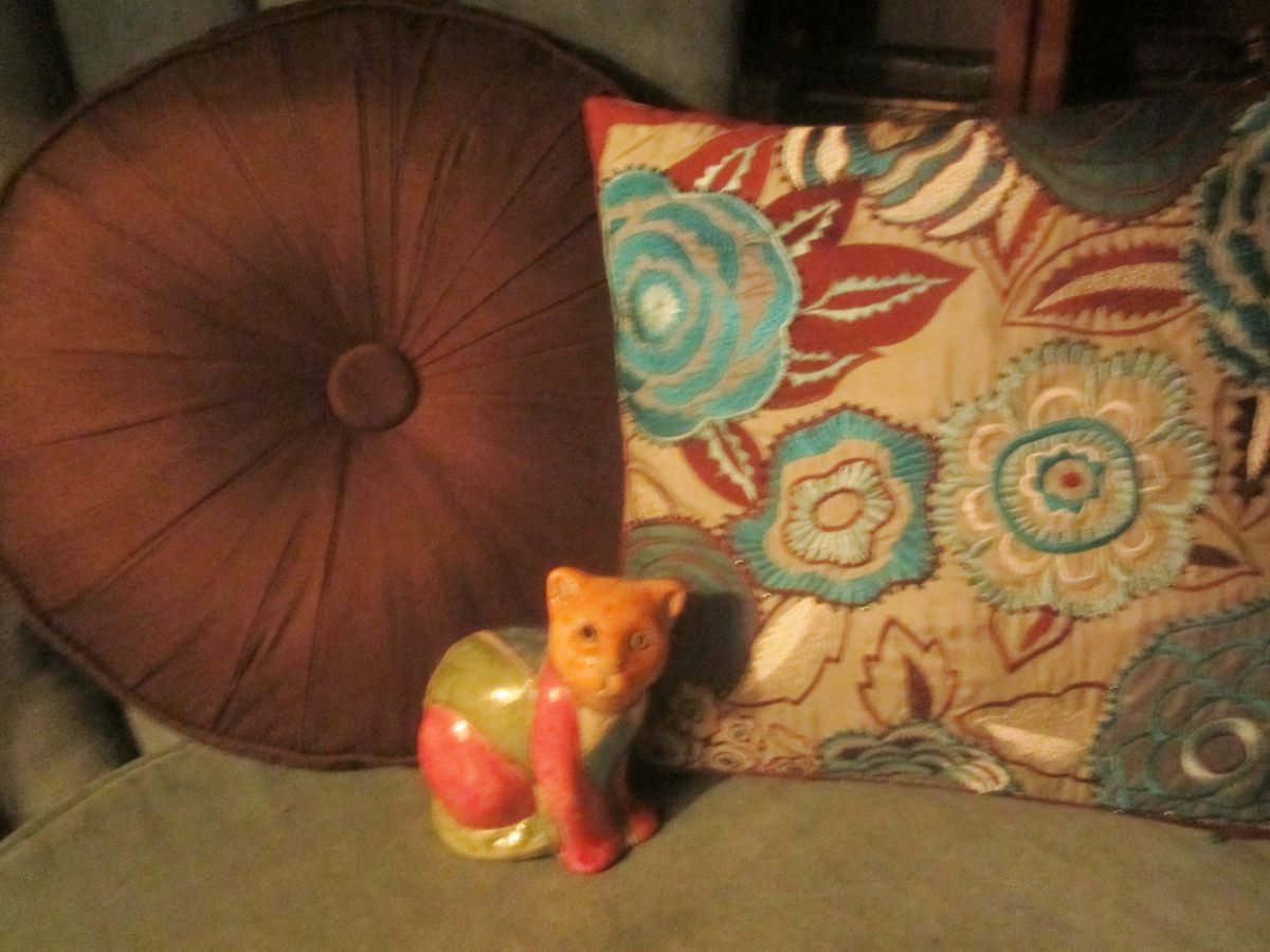 Like new pillows for a dollar or so apiece. There's my cat from Africa, too! Yard sales are great for finding decorative household items.