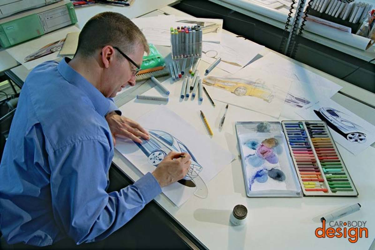 Mercedes designer using coloring tools to draw a car