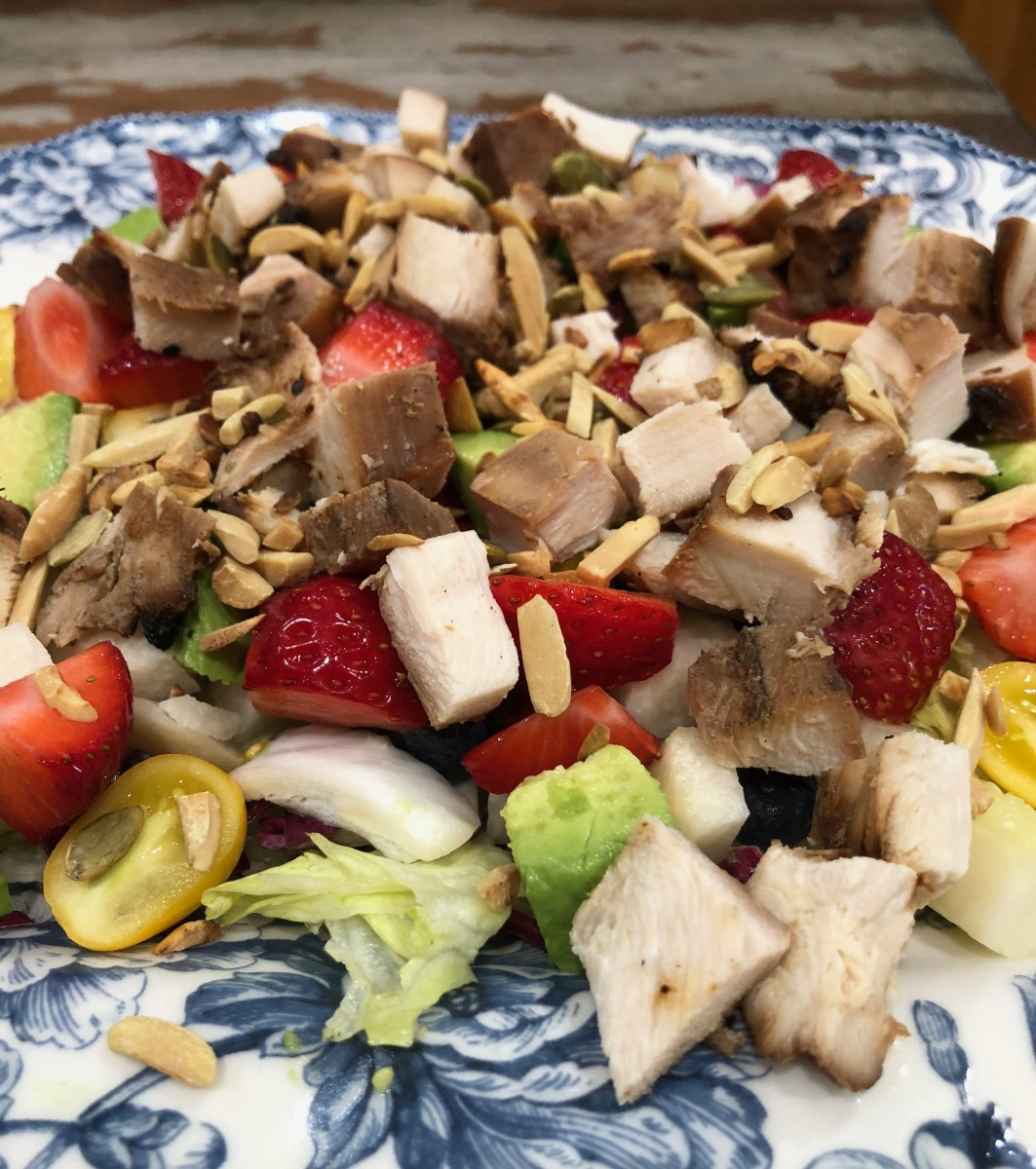 This is the same salad with grilled chicken and toasted almonds and pumpkin seeds on top.