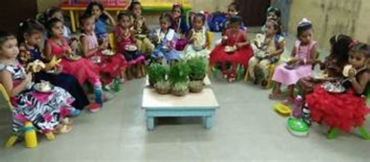 Little Girls enjoying their Prasaad with Gaur Maa ....