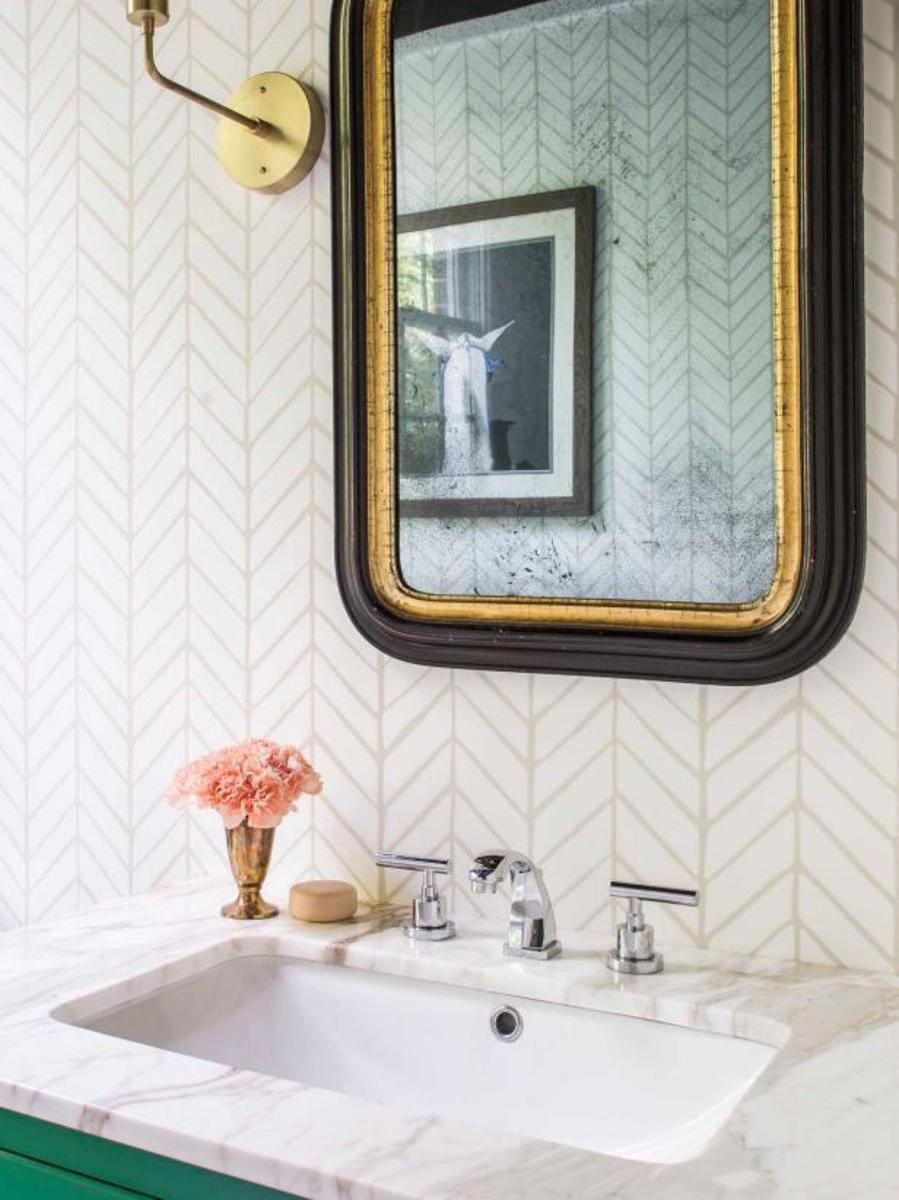 The beautiful antique bathroom mirror.