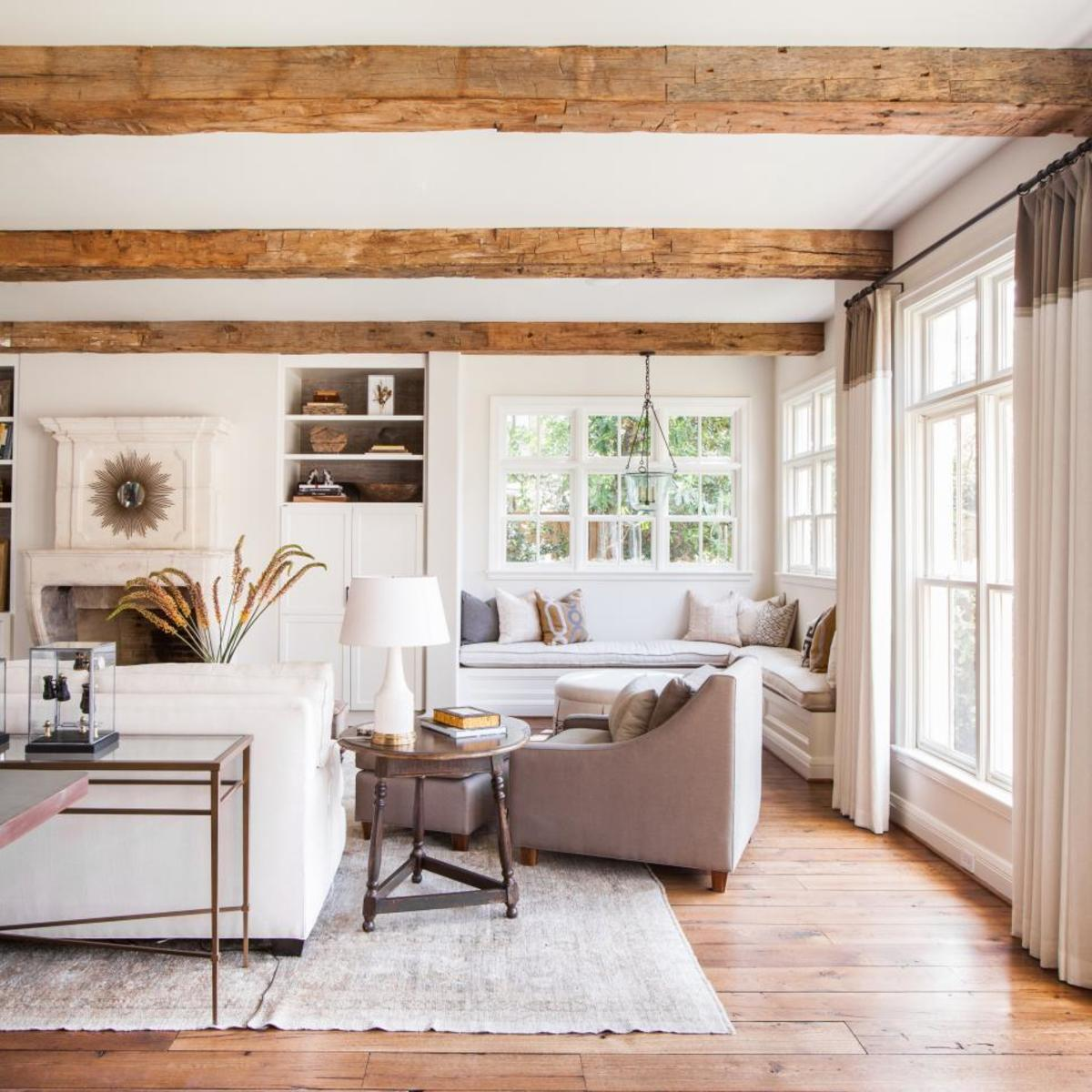 The rugs and the curtains in the window and the white furniture and wood beams and the wood floors!