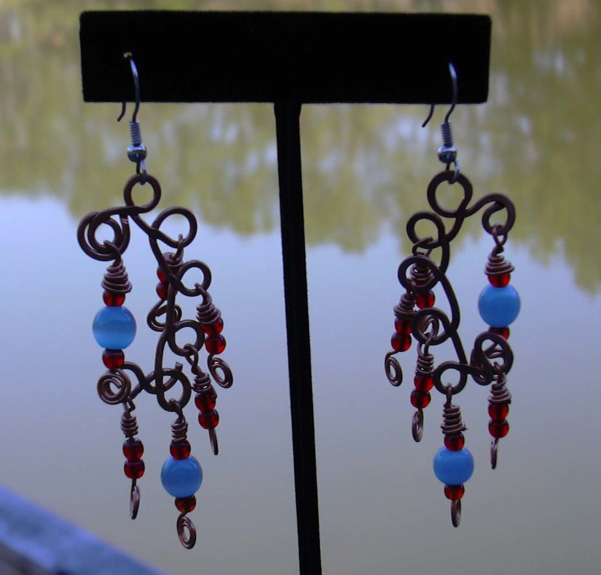 Handcrafted artisan copper and Czech glass chandelier earrings.