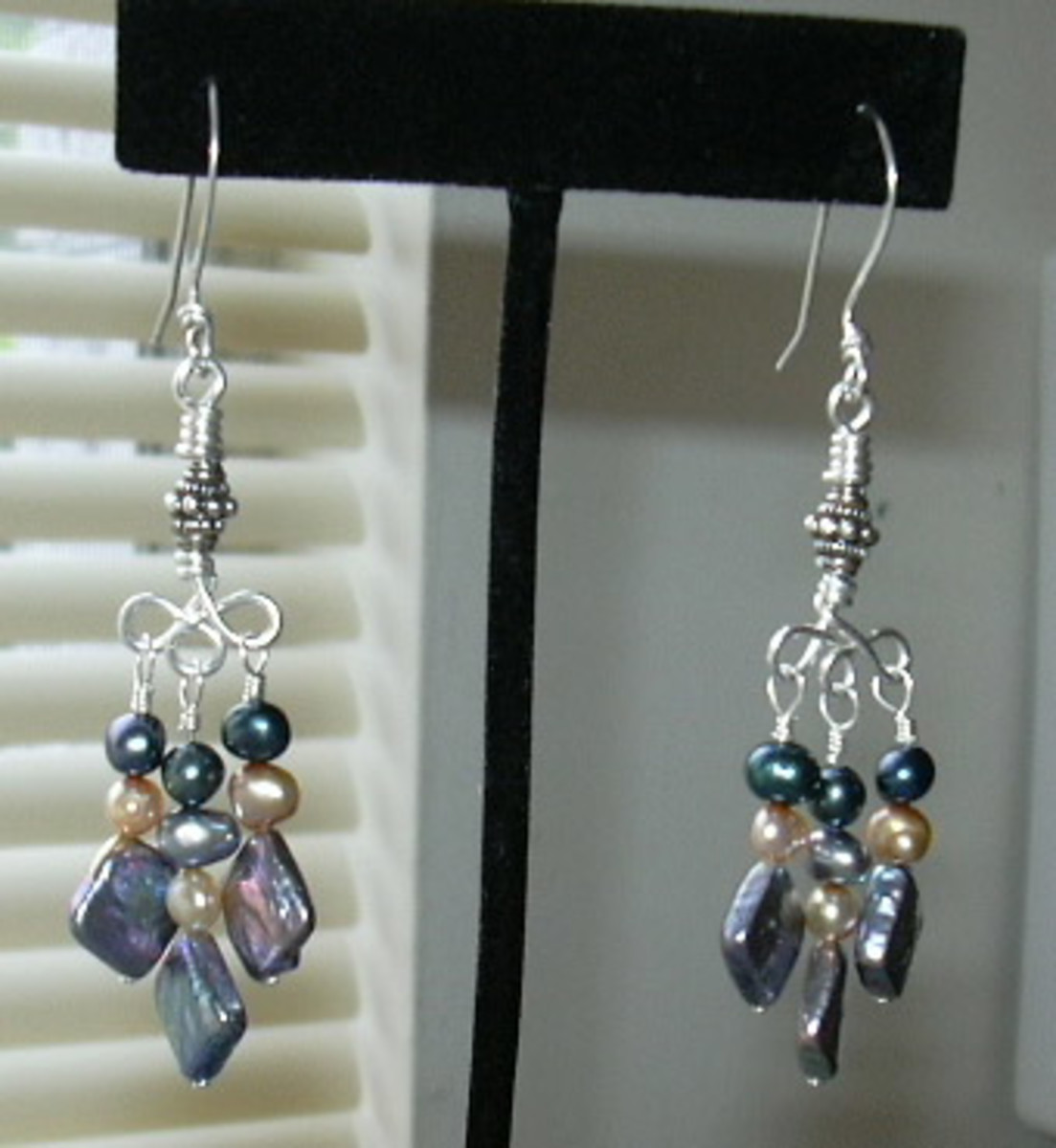 Wire wrapped .925 sterling silver and cultured freshwater pearl chandelier earrings.  I handcrafted all the jewelry wire in this pair, including the ear-wires.
