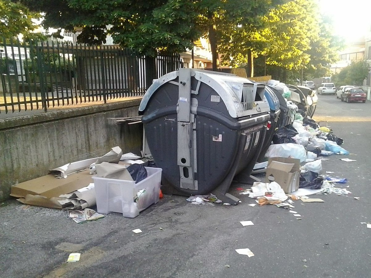 Overflowing garbage cans are a common sight everywhere in Rome.