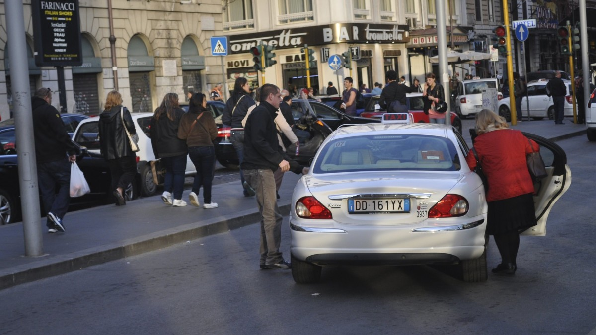 Taking a Taxi is a costly way to avoid the cramped, unpredictable nature of Rome's bus service.