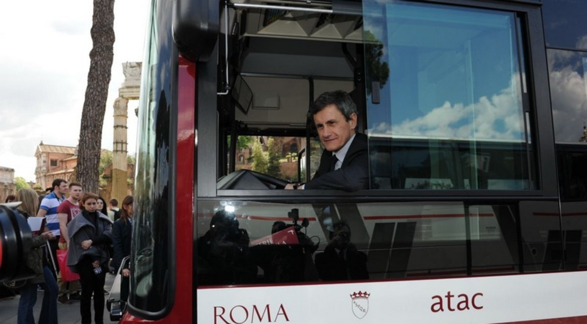 Former mayor of Rome Gianni Alemanno showing off one of Rome's new buses and looking suspiciously pleased with himself.