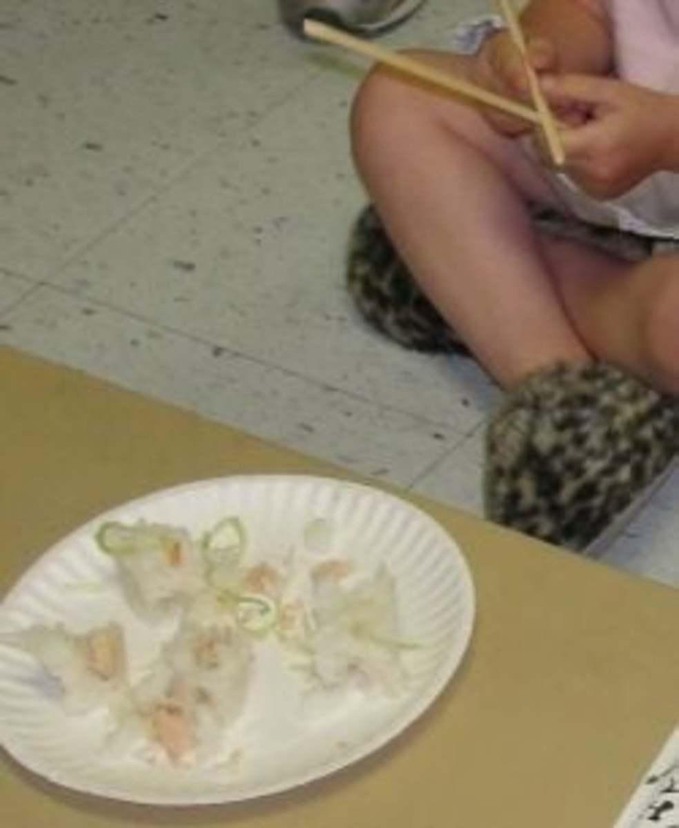 Eating the sushi using chopsticks