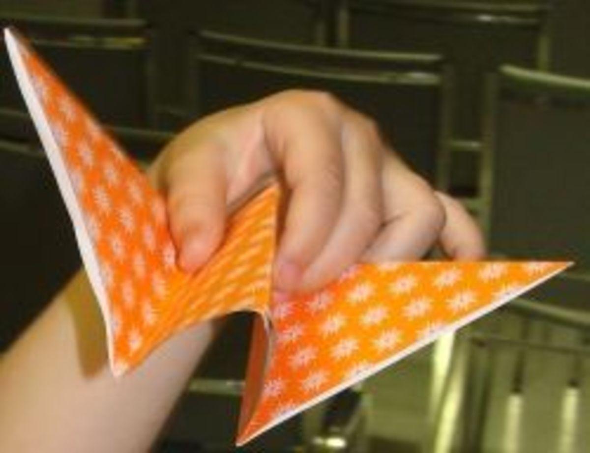 Folding origami butterflies