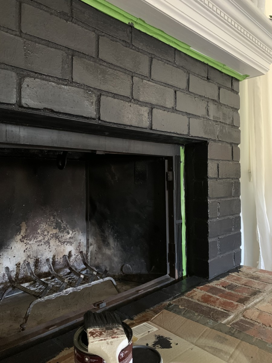 Place painter's tape around the fireplace to help keep clean and crisp paint lines.