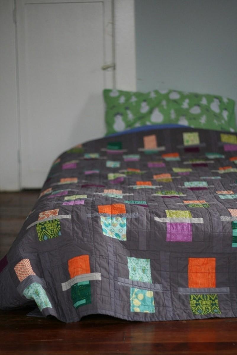 I think brightly coloured fabrics look fab against a grey background.