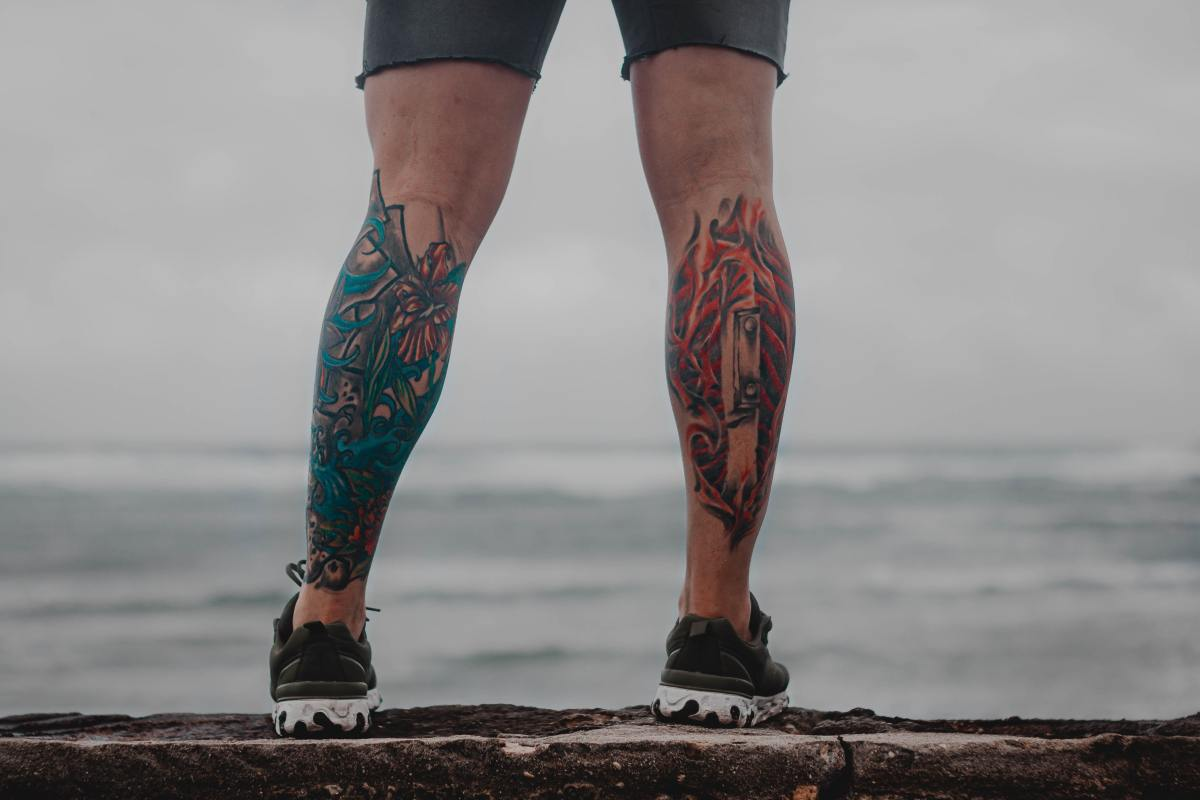 The masses of muscles on the backs of the calves protect the bone, so that spot is less painful for tattoos.