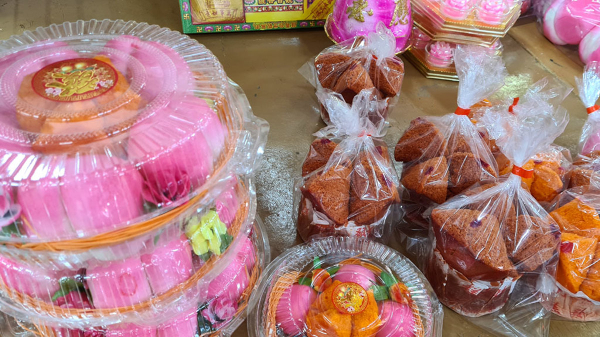 """Chinese cakes and """"longevity buns,"""" Such food items are commonly seen at community altars during the Chinese Ghost Festival."""