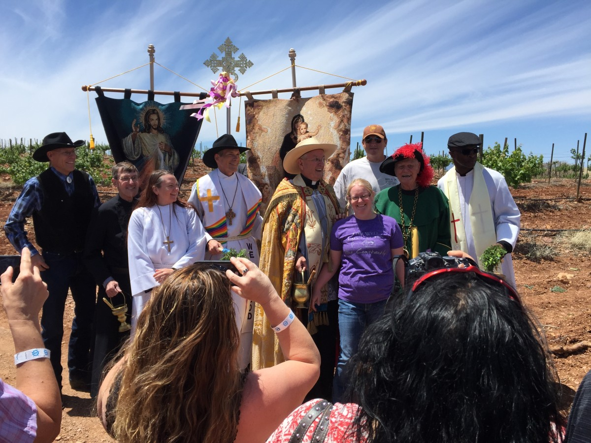 Local clergy in the vineyard in April 2017 to bless the vines at the start of the growing season. Woman in blue is Dr Dutt's granddaughter who now runs the winery. Dr. Dutt is to the right of her and wearing the garb of an ancient order of winemaker.