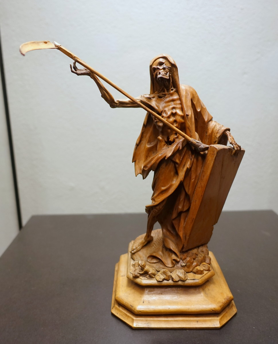 A wood sculpture depicting death as the Grim Reaper. Made in southern Germany in the late 18th century, this sculpture is in the Museum Schnütgen in Cologne. Was Mot the inspiration for this famous and frightening character?