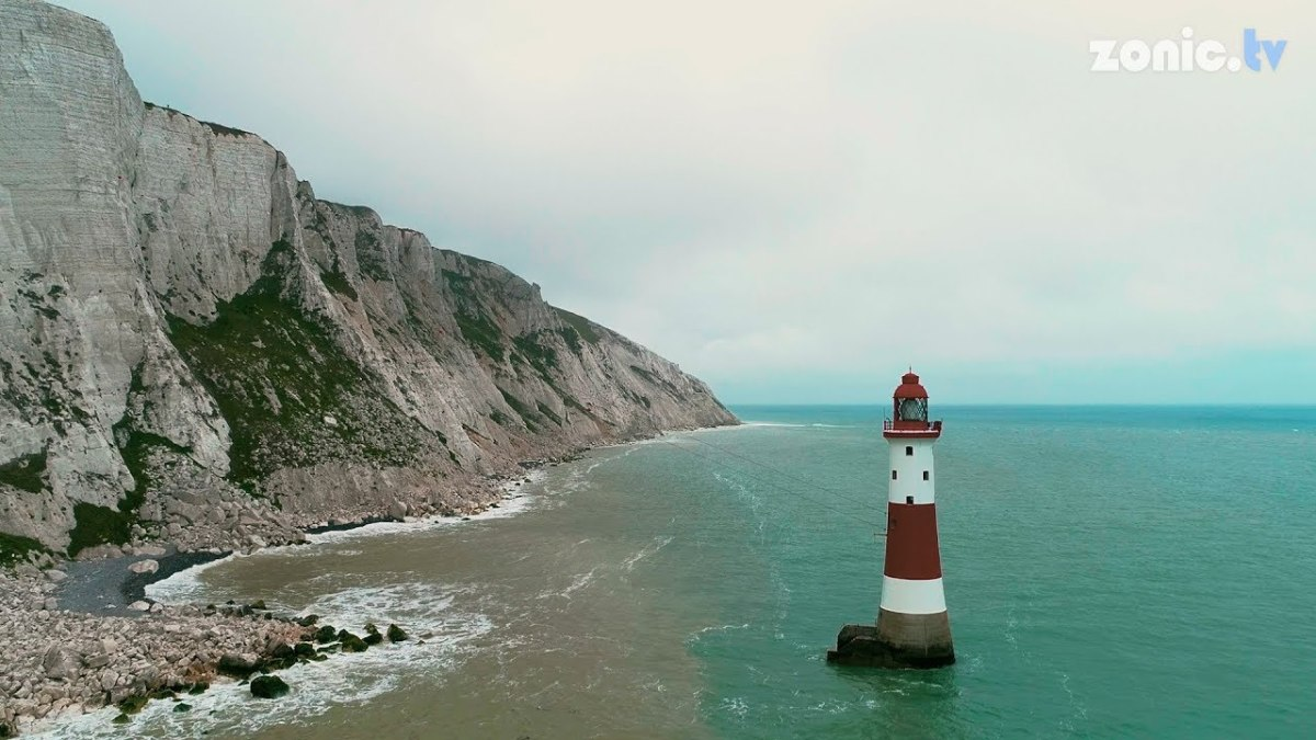 Beachy Head Light, showing scale between lighthouse and cliffs.  It is accessible only from the sea