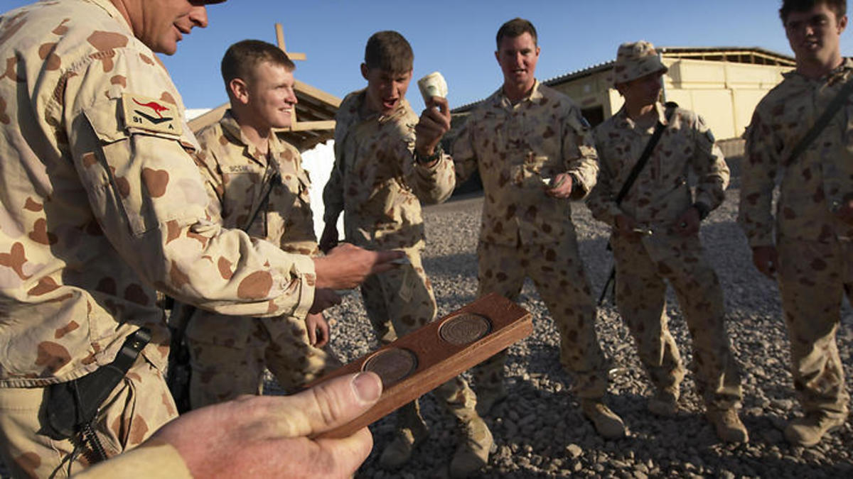 Australian soldiers enjoying a game of two up