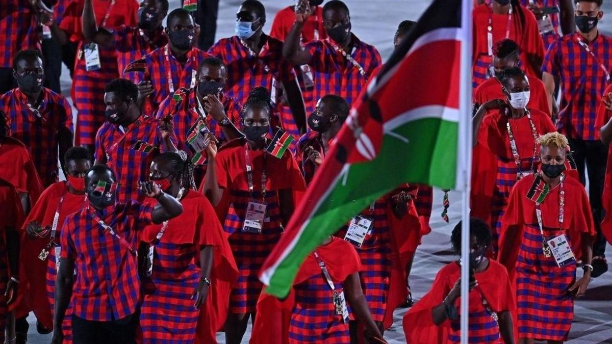 Kenyan athletes carrying their flag in a pst event.