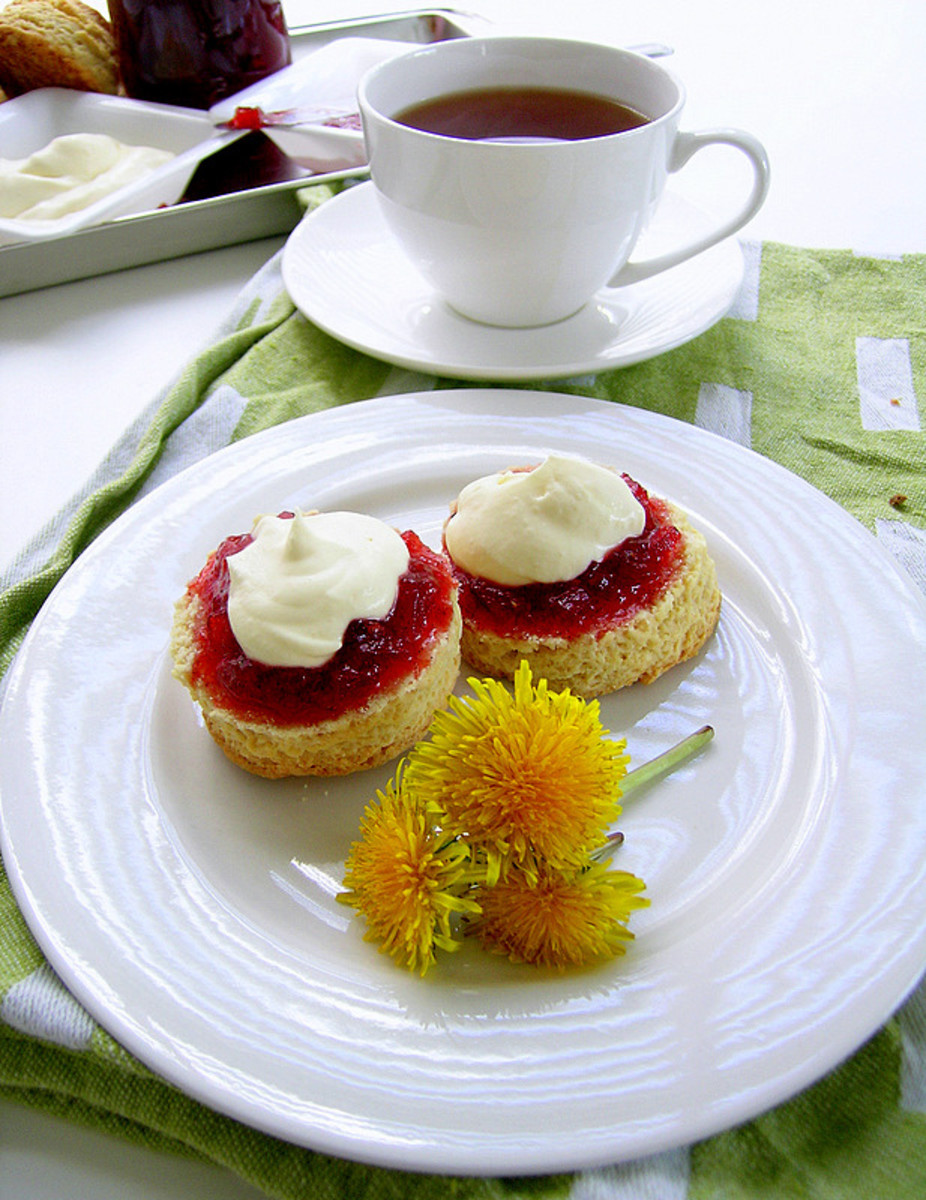 a cup of tea served with scones