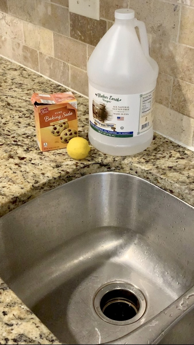 All you need to clean your sink disposal is baking soda, white distilled vinegar, and a lemon.