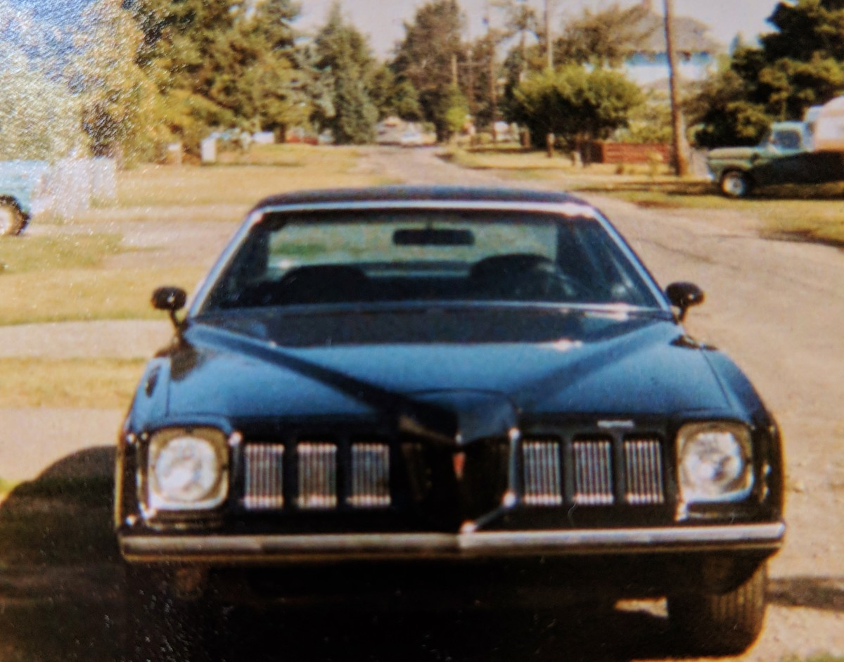 '73 Pontiac GrandAm, Blk, blk, blk with elec sunroof and 455. This bad girl was her all time favorite