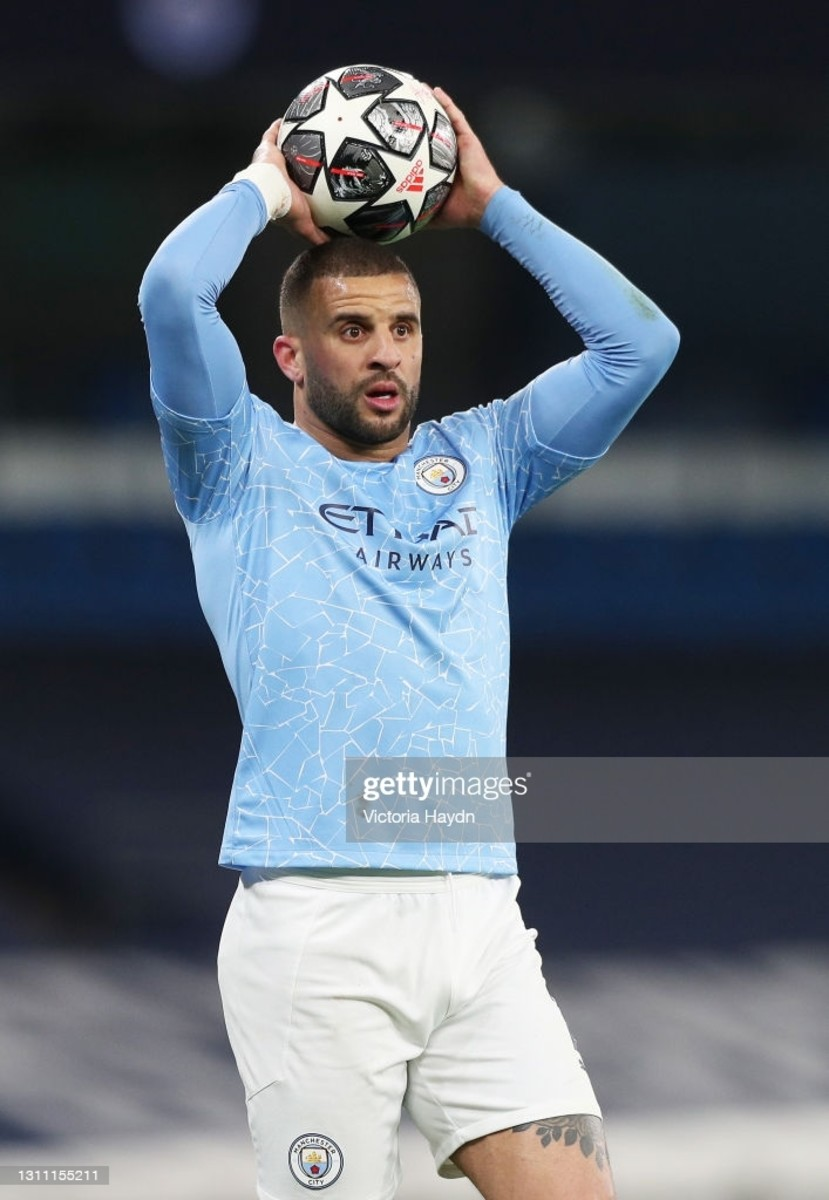 Manchester City's Kyle Walker taking a throw.