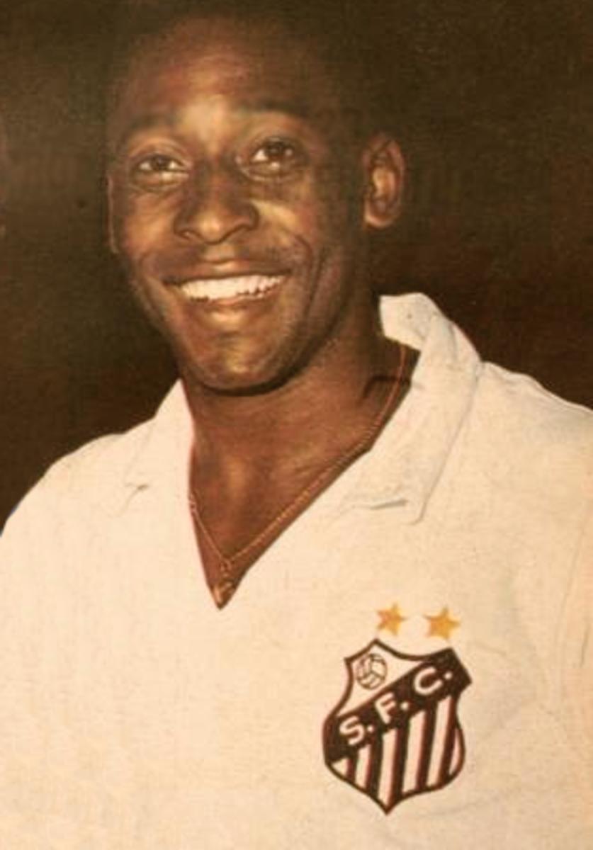 Legendary foottballer Pele in a Santos jersey.