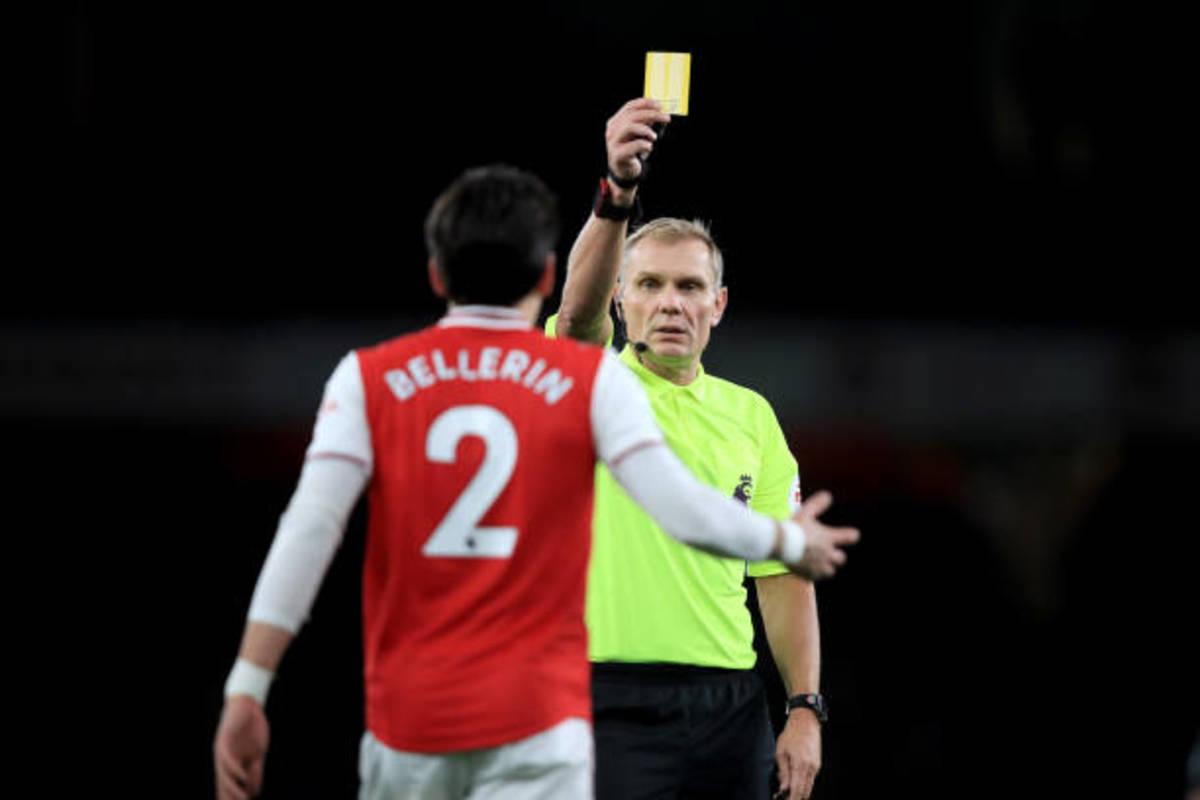 Arsenal's Hector Bellerin recieving a yellow card.