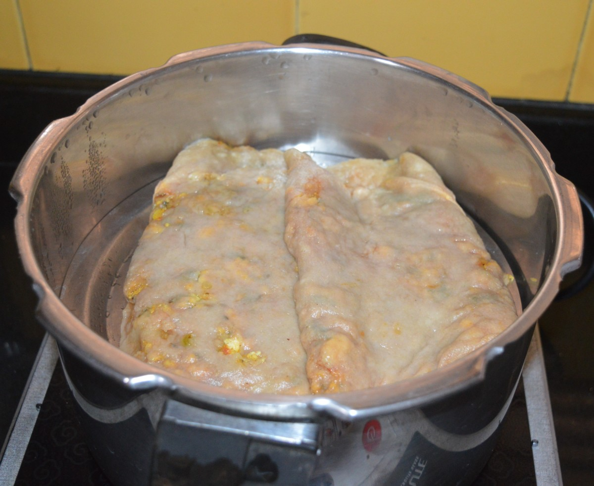Prepare the remaining dough similarly with the tomato sauce and stuffing. Steam-cook for 20 minutes by placing each of them separated with some space.