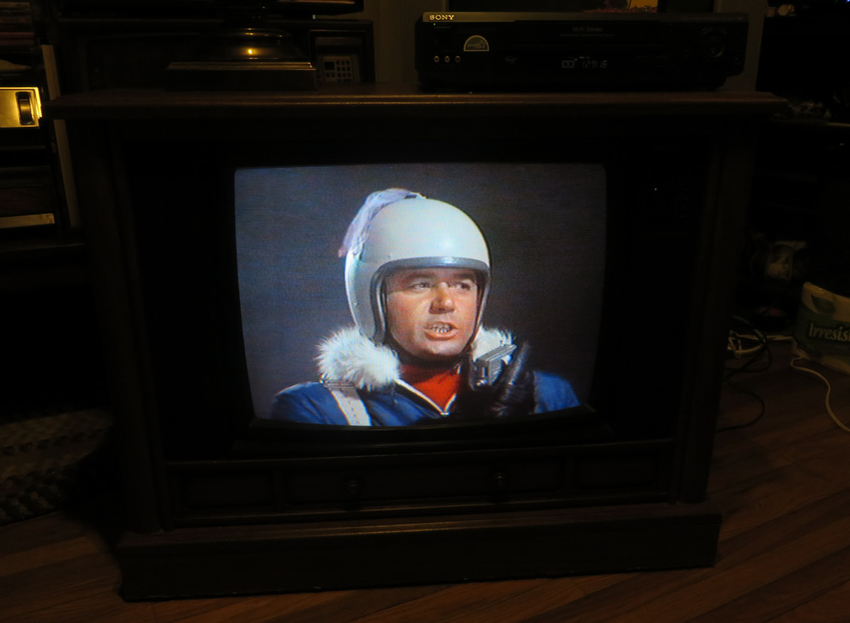 Guy Williams as Professor John Robinson on the Crosley Color Television CC2546-P102.  Lost in Space (TV Series) Junkyard in Space (1968) Columbia House Collectors VHS tape. Here he is flying his Jet Pack looking for the Junkman's power source.