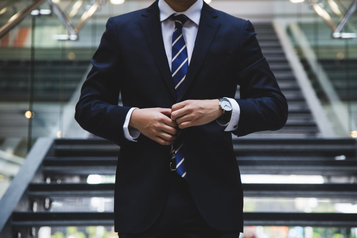 While a suit might be overkill, dressing well can help increase your chances of being selected for an upgrade.