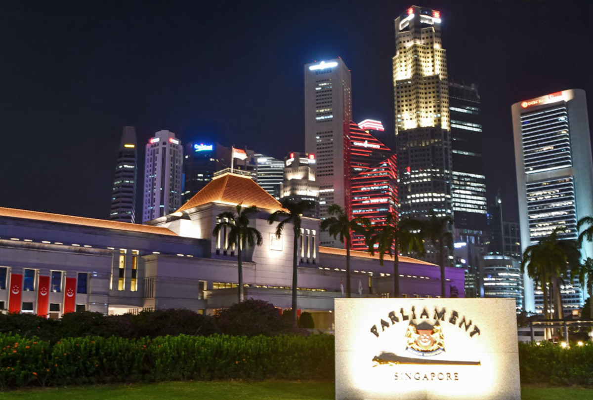 The Parliament of Singapore with financial district skyscrapers in the background.
