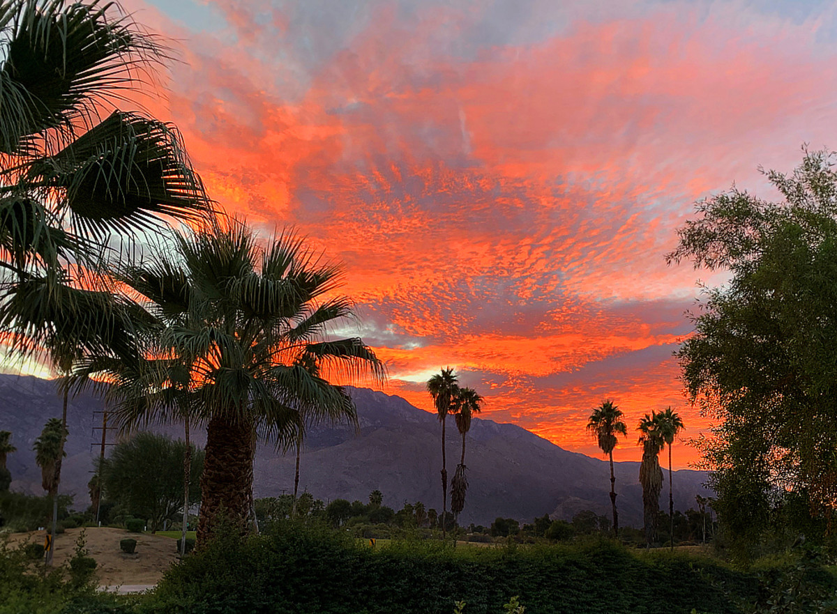 View of sunset over San Jacinto Peak from a neighborhood street in Palm Springs, CA.