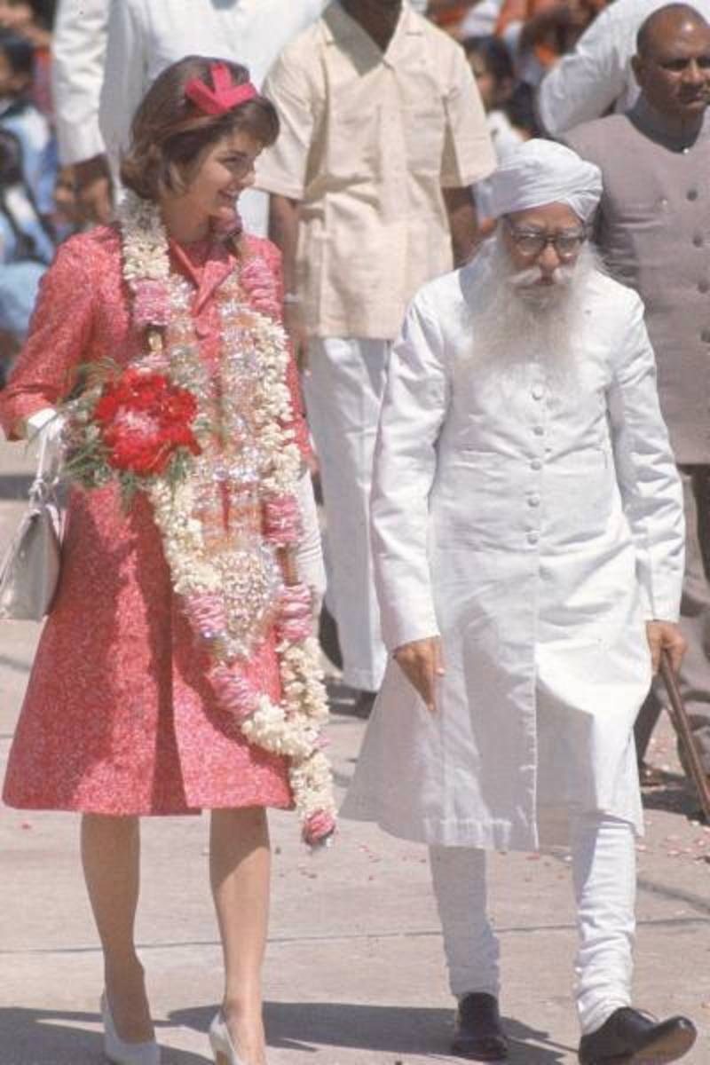 First Lady Jacqueline Kennedy showed that pink truly is the navy blue of India on a trip to Jaipur